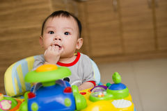 6-month-old-asian-baby-girl-chewing-fingers-19605657